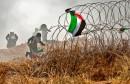 86049-صور-اشتباكات-عنيفة-بين-الفلسطينيين-وقوات-الاحتلال-فى-غزة-(4)